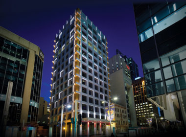 99 St Georges Terrace at night with facade lights on