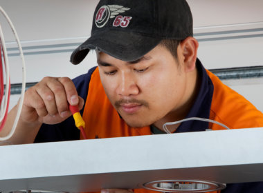 Mondoluce staff member installing a luminaire